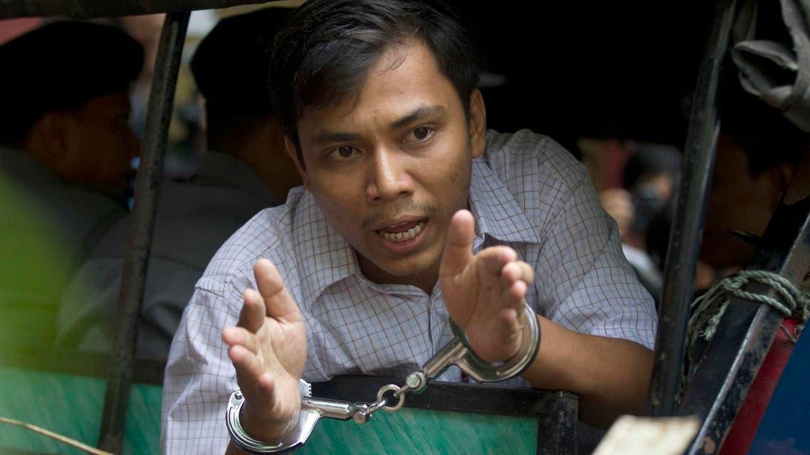 Reuters journalist Kyaw Soe Oo speaks from a police truck as he leaves a court after his trial on May 2, 2018, Yangon, Myanmar. (AP)