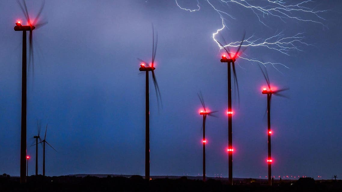 Lightning strikes close to wind turbines in a wind energy park during a thunderstorm near Sieversdorf, eastern Germany, on August 28, 2016. (AFP)
