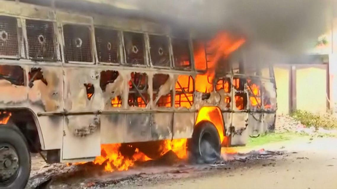 A bus on fire during the protest against construction of Vedanta Resources copper smelter in Thoothukudi, Tamil Nadu, on May 23, 2018. (Reuters)