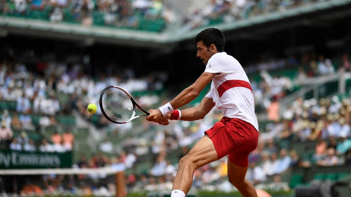 Serbia's Novak Djokovic plays a return to Brazil's Rogerio Dutra Silva during their men's singles first round match on day two of The Roland Garros 2018 French Open tennis tournament in Paris on May 28, 2018.  CHRISTOPHE SIMON / AFP