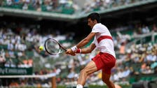 Djokovic's bid for second French Open off to glum-faced start