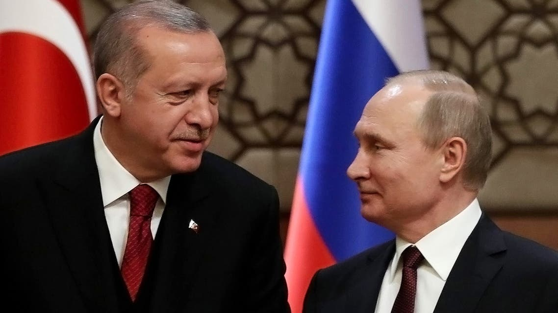 Turkey's President Recep Tayyip Erdogan (L) and Russia's President Vladimir Putin look at each other during a joint press conference with the Iranian president, as part of a tripartite summit on Syria, in Ankara, on April 4, 2018. The presidents of Iran, Turkey and Russia met on April 4, 2018 for their second tripartite summit in under six months, aiming to speed the peace process for Syria and bolster their influence in the country.