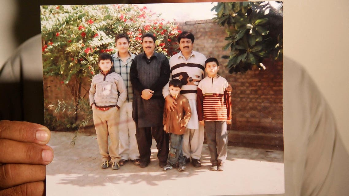 In this April 19, 2016 photo, Jamil Afridi, the elder brother of Dr. Shakil Afridi, shows a family photo with his brother Shakil (3L). (AFP)