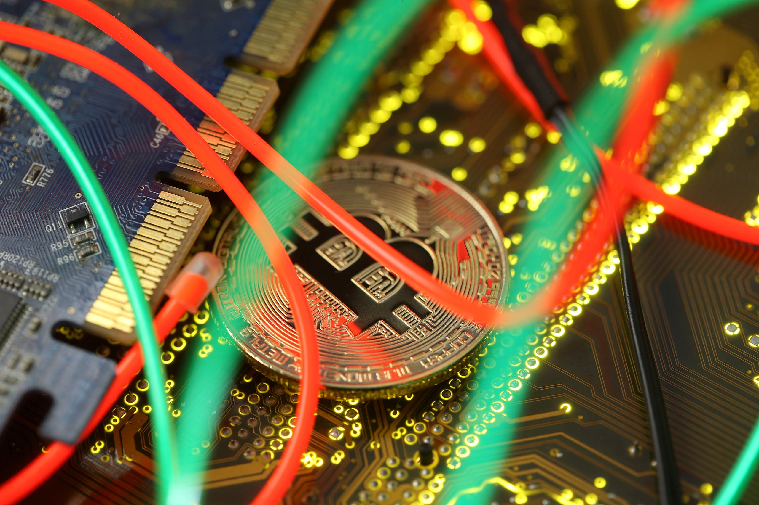 Representation of the Bitcoin virtual currency standing on the PC motherboard is seen in this illustration picture, February 3, 2018. (Reuters)