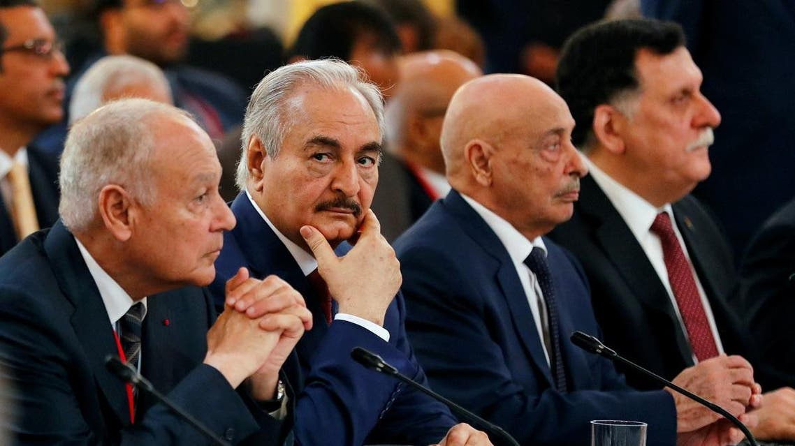 Khalifa Haftar, the military commander who dominates eastern Libya, Aguila Saleh Issa, president of the eastern Libyan House of Representatives, and Libyan Prime Minister Fayez al-Sarraj during an international conference on Libya at the Elysee Palace in Paris. (Reuters)
