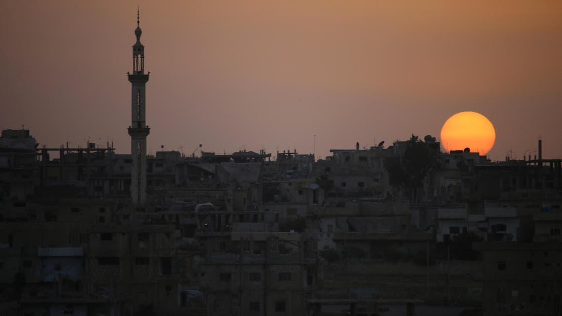 A general view shows the sun setting over a rebel-held area in the southern Syrian city of Daraa on April 20, 2018.  After the capture of Eastern Ghouta the Syrian president now has forces ready to redeploy elsewhere in the war-ravaged country. The Islamists and jihadists that hold the northwest province of Idlib remain a threat, but analysts say the Syrian president's priority will likely be the southern province of Daraa, where protests against his rule first broke out in 2011. Mohamad ABAZEED / AFP