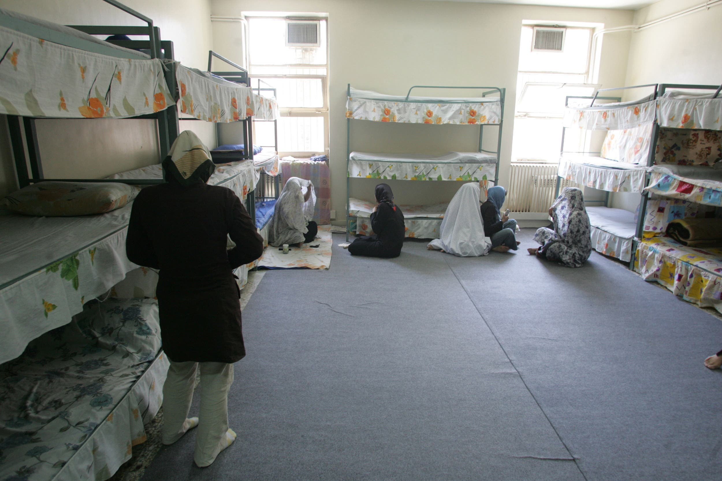 Iranian women inmates sit at their cell in the infamous Evin jail, north of Tehran, on 13 June 2006. (AFP)