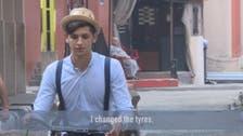 Beirut's dapper barber-on-a-bike offers curbside cuts