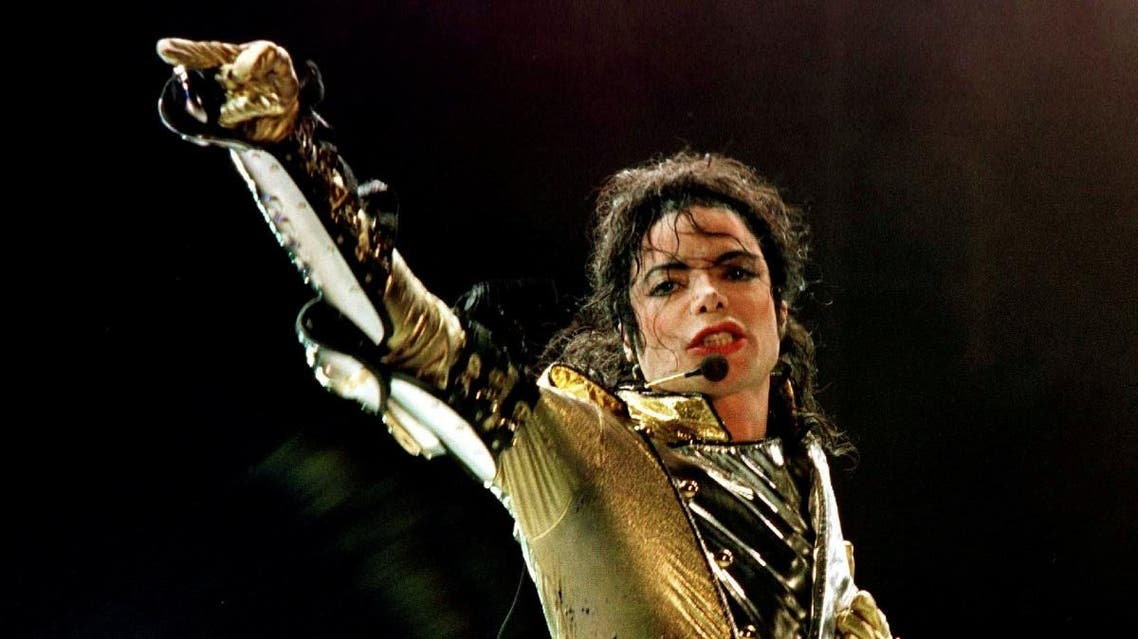 """Michael Jackson performs during his """"HIStory World Tour"""" concert in Vienna, July 2, 1997. (Reuters)"""