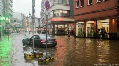 """شاهد.. الأمطار تغرق شوارع و""""مولات"""" مدن ألمانية"""