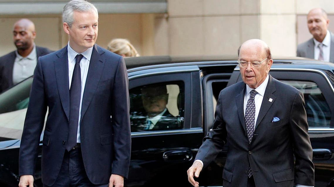 French Finance Minister Bruno Le Maire, (left), welcomes US Secretary of Commerce Wilbur Ross prior to their meeting at French Economy Ministry in Paris, on Thursday, May 31, 2018. (AP)