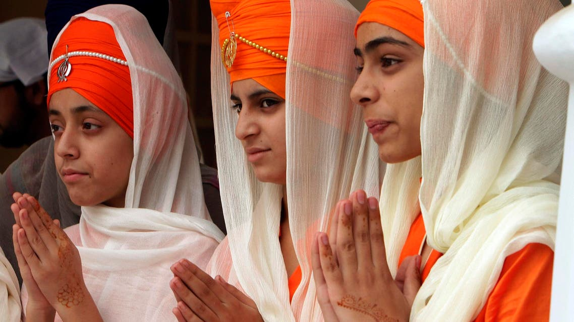 Sikh girls attend a religious festival to celebrate the 549th birth anniversary of their spiritual leader Baba Guru Nanak, at Nankana Sahib near Lahore, Pakistan, on Nov. 4, 2017. (AP)