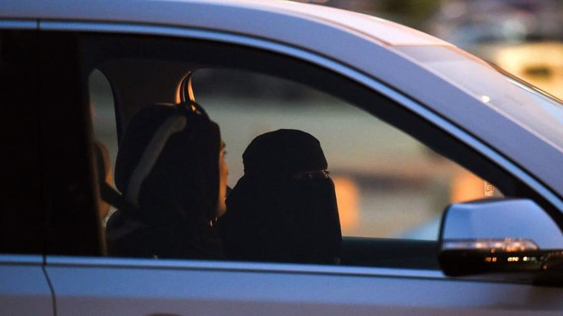 A Saudi woman sits in the driver's seat with a Lebanese driving instructor as they test-drive a car during an automotive exhibition for women in the capital Riyadh on May 13. (AFP)