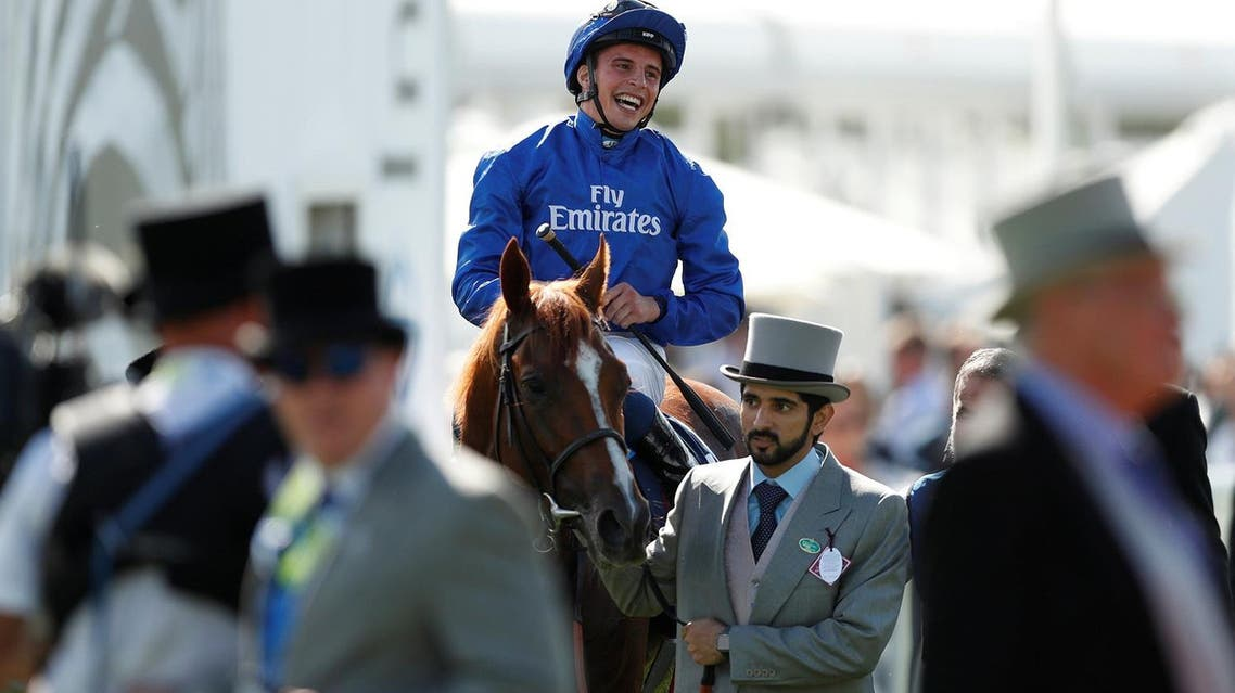 Sheikh Hamdan leads Godolphin's Masar trained by Charlie Appleby and ridden by William Buick, after winning the $1.2-million Epsom Derby. (Reuters)