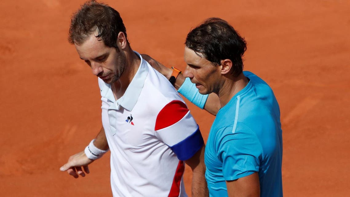 Spain's Rafael Nadal with France's Richard Gasquet after winning their third round match. (Reuters)