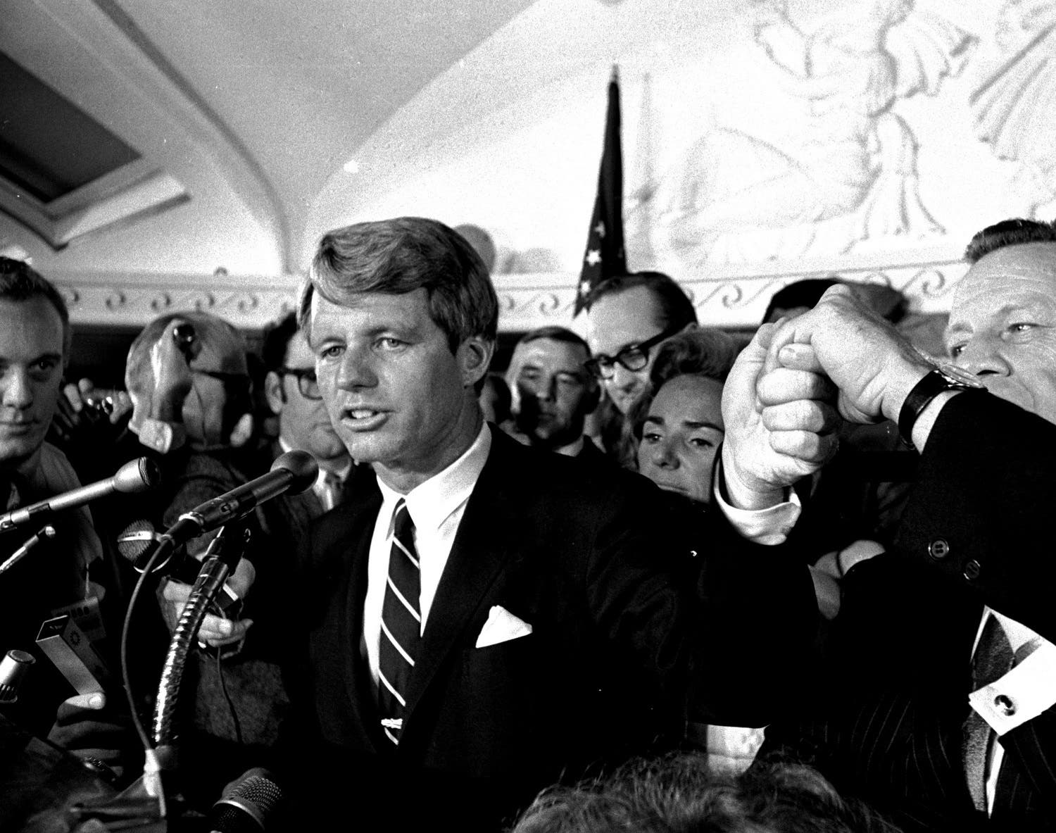 Sen. Robert F. Kennedy addresses a throng of supporters in the Ambassador Hotel before he turned into the kitchen corridor and was critically wounded. (AP)