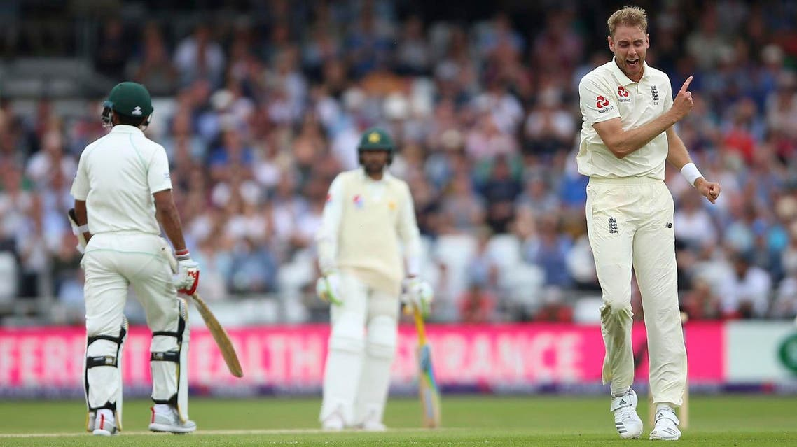 England's Stuart Broad celebrates after taking the wicket of Pakistan's Hasan Ali on day three of the second test match at Headingley, Leeds, England, on Sunday June 3, 2018. (AP)