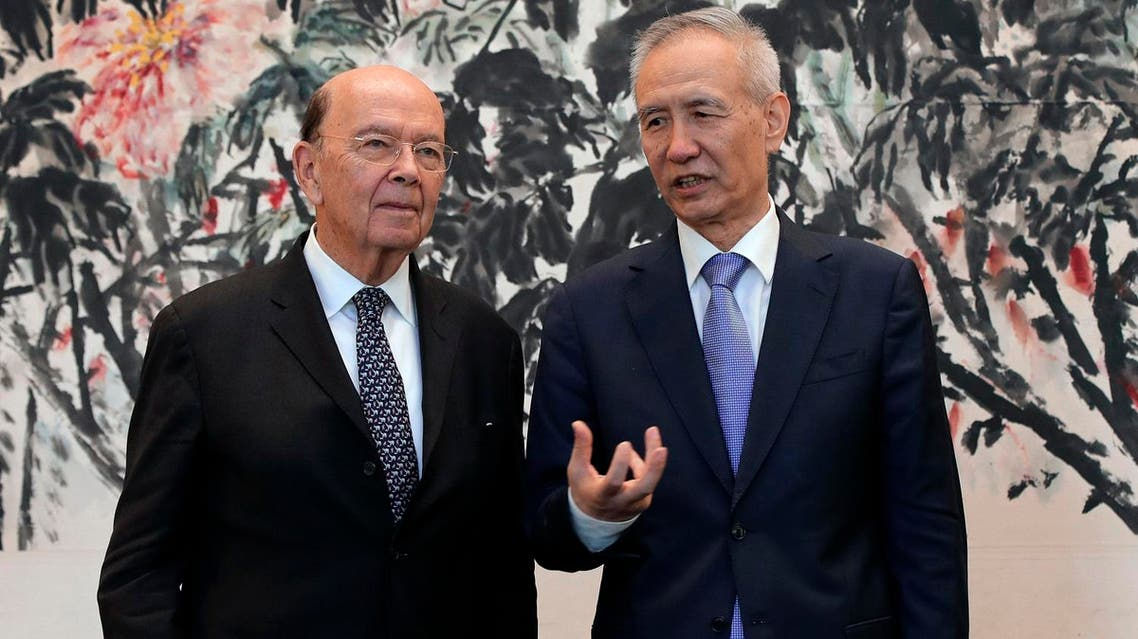 US Commerce Secretary Wilbur Ross (L) chats with Chinese Vice Premier Liu He during a photograph session after their meeting at the Diaoyutai State Guesthouse in Beijing on June 3, 2018. (AFP)