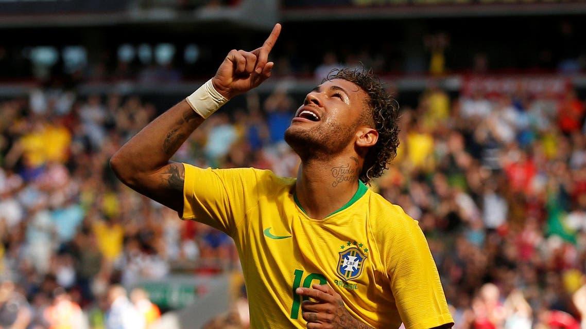 Brazil's Neymar celebrates scoring their first goal. (Reuters)