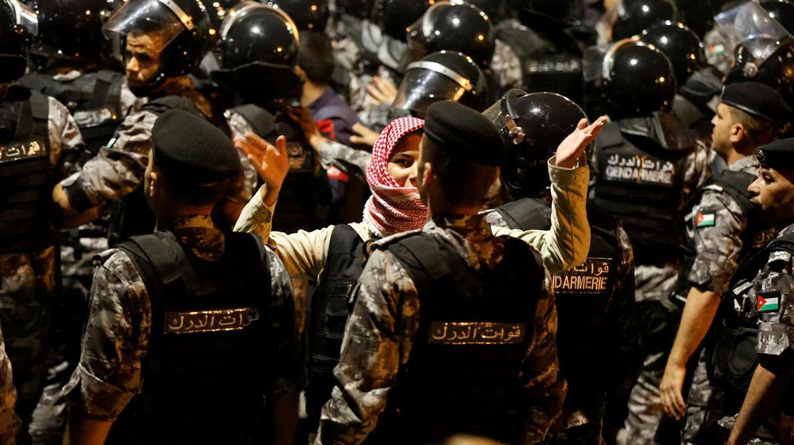 Police officers secure the office of Jordan's prime minister during a protest in Amman. (Reuters)