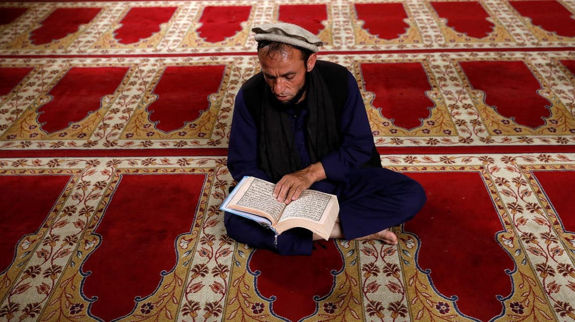 An Afghan man reads the Koran at a mosque on the first day of the holy month of Ramadan in Kabul, Afghanistan. (Reuters)