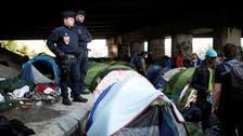 Paris police evacuate two more migrant camps