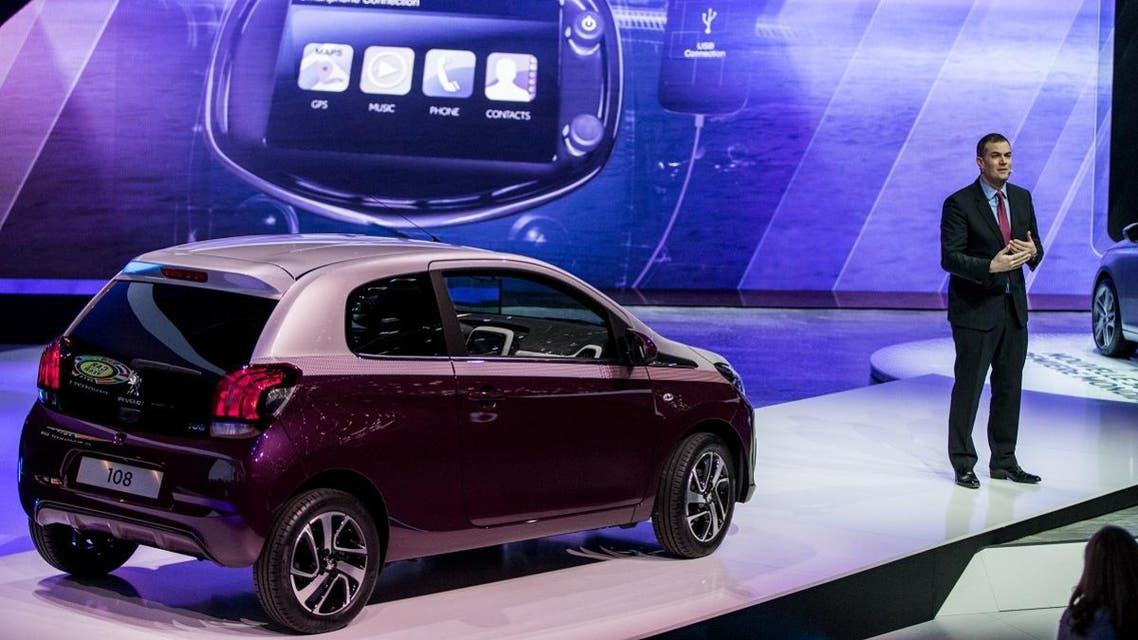 Peugeot Brand CEO at PSA Peugeot Citroen Maxime Picat presents the Peugeot's 108 at the group's stand of the Geneva Motor Show. (File photo: AFP)