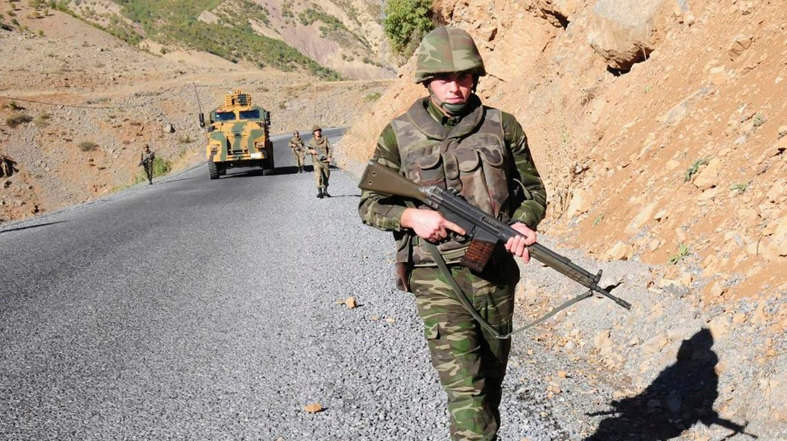 Turkish soldiers patrol a road near Cukurca in the Hakkari province, southeastern Turkey, near the Turkish-Iraqi border October 22, 2011. Turkish troops killed 32 Kurdish militants in clashes in Cukurca Kazan valley, in Hakkari province in southeast Turkey, state-run television TRT reported on Saturday, in the third day of an offensive to avenge the deaths of 24 soldiers this week. Turkey's leaders have vowed revenge after one of the worst losses of life suffered by the army since the separatist insurgency began in 1984, when PKK guerrillas mounted a series of deadly night-time raids on army outposts in Turkey's mountainous southeast on Wednesday. REUTERS/Stringer (TURKEY - Tags: POLITICS MILITARY)