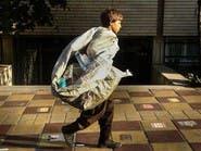 بالصور.. عمالة الأطفال في إيران بين النفايات والأمراض