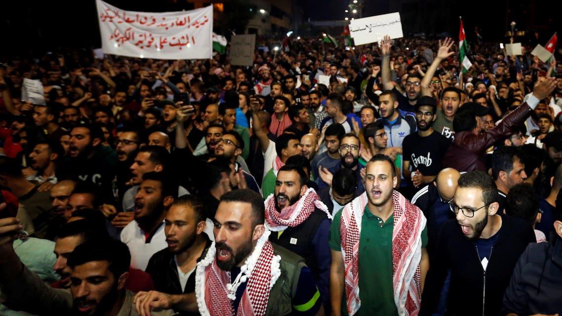 Protesters shout slogans during a protest in Amman, Jordan June 4, 2018. REUTERS/Muhammad Hamed