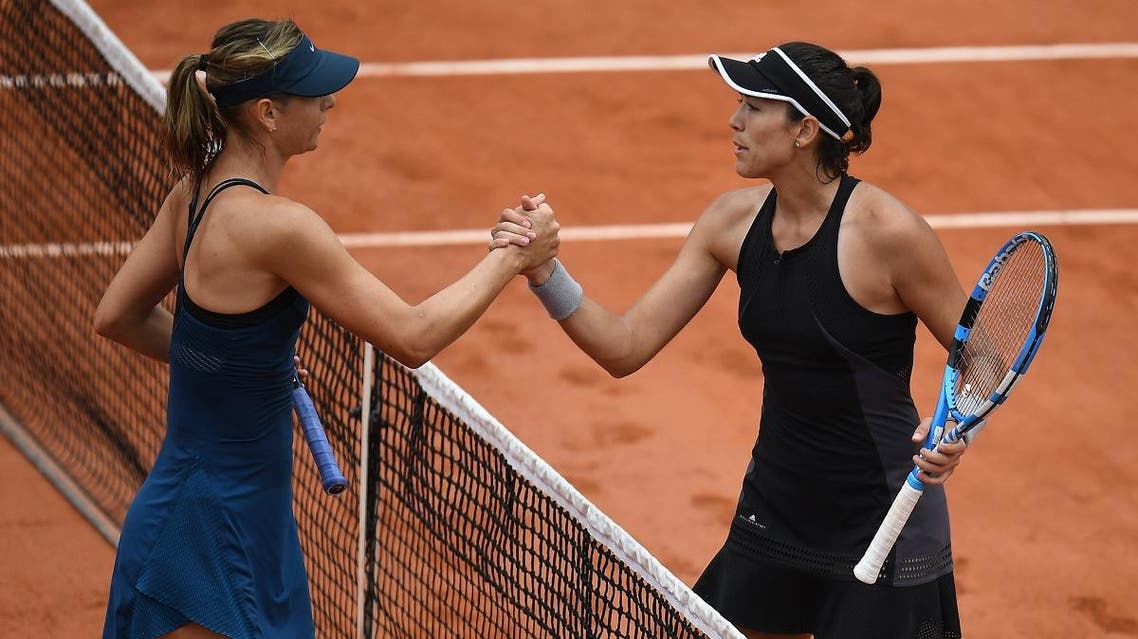 Spain's Garbine Muguruza (R) is congratulated by Russia's Maria Sharapova after winning. (AFP)