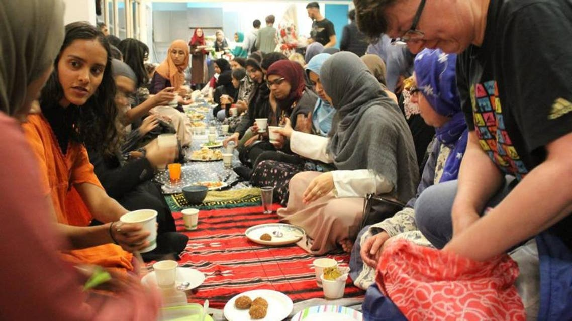 Ladies sitting down to the 'Green Iftar' eating from crockery and cutlery brought from home to prevent plastic waste. (Supplied)