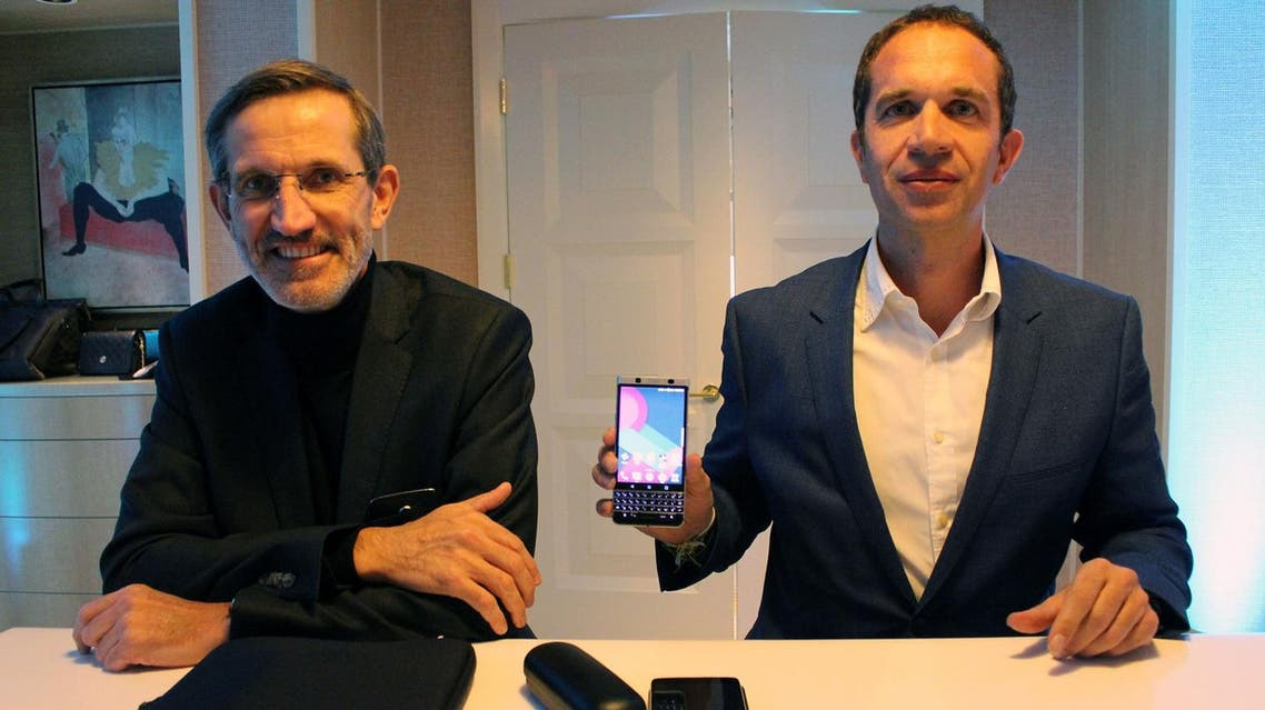 TCL Communications head of research Alain Lejeune (L) and chief executive Nicolas Zibell pose at the Consumer Electronics Show in Las Vegas on January 4, 2017 to discuss the Chinese electronics titan's plan to breathe new life into BlackBerry smartphones. (AFP)