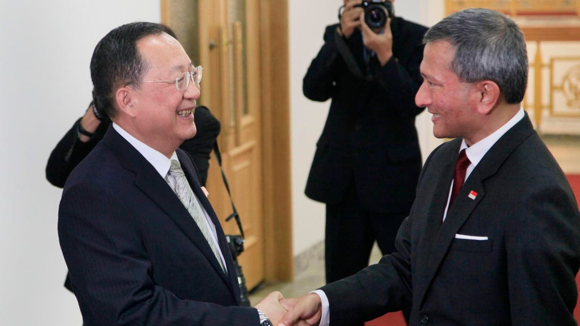 ( SiNGAPORE FOREIGN MINISTER WITH NORTH KOREAN COUNTERPART. (AP)