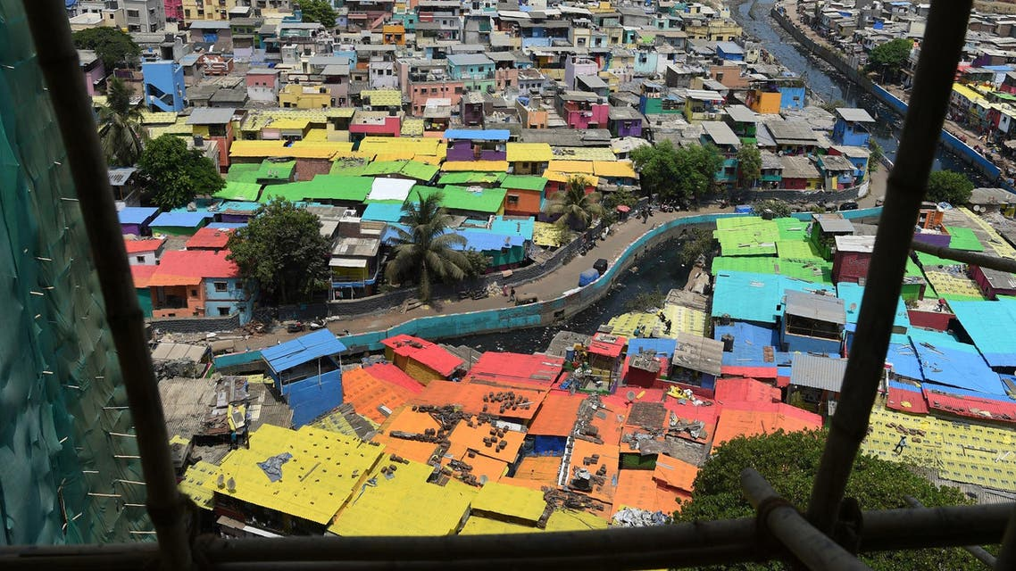 A view of houses painted in bright colors at a fishing area in Mumbai on June 2, 2018. (AFP)