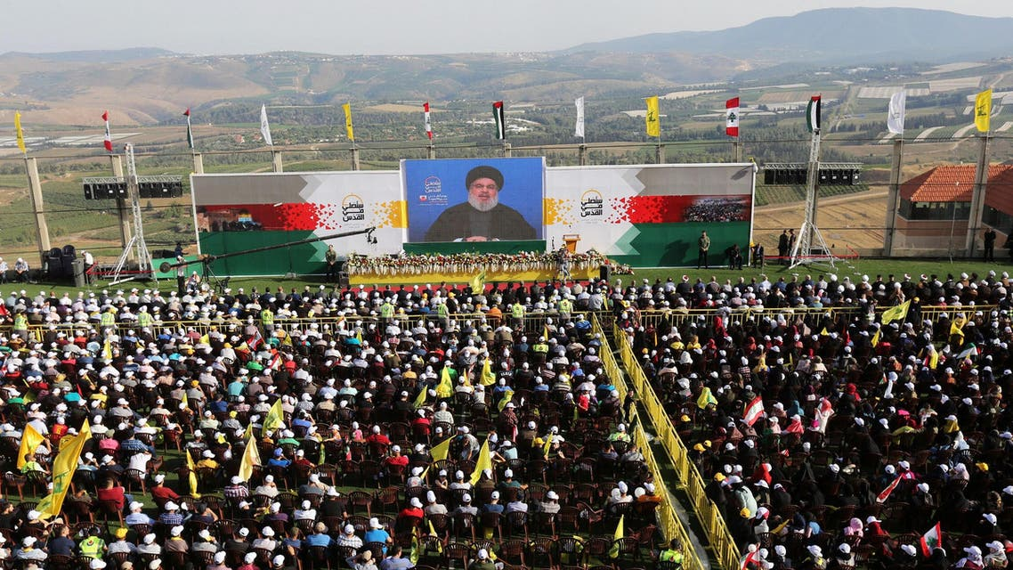 Hassan Nasrallah addresses his supporters via a screen during a rally near the border with Israel on June 8, 2018. (Reuters)