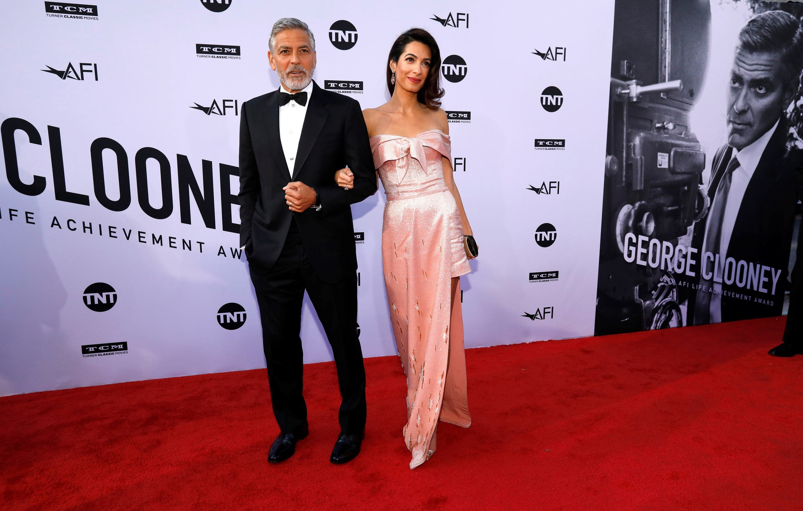 Actor Clooney and his wife Amal pose at the 46th AFI Life Achievement Award Gala in Los Angeles. (Reuters)
