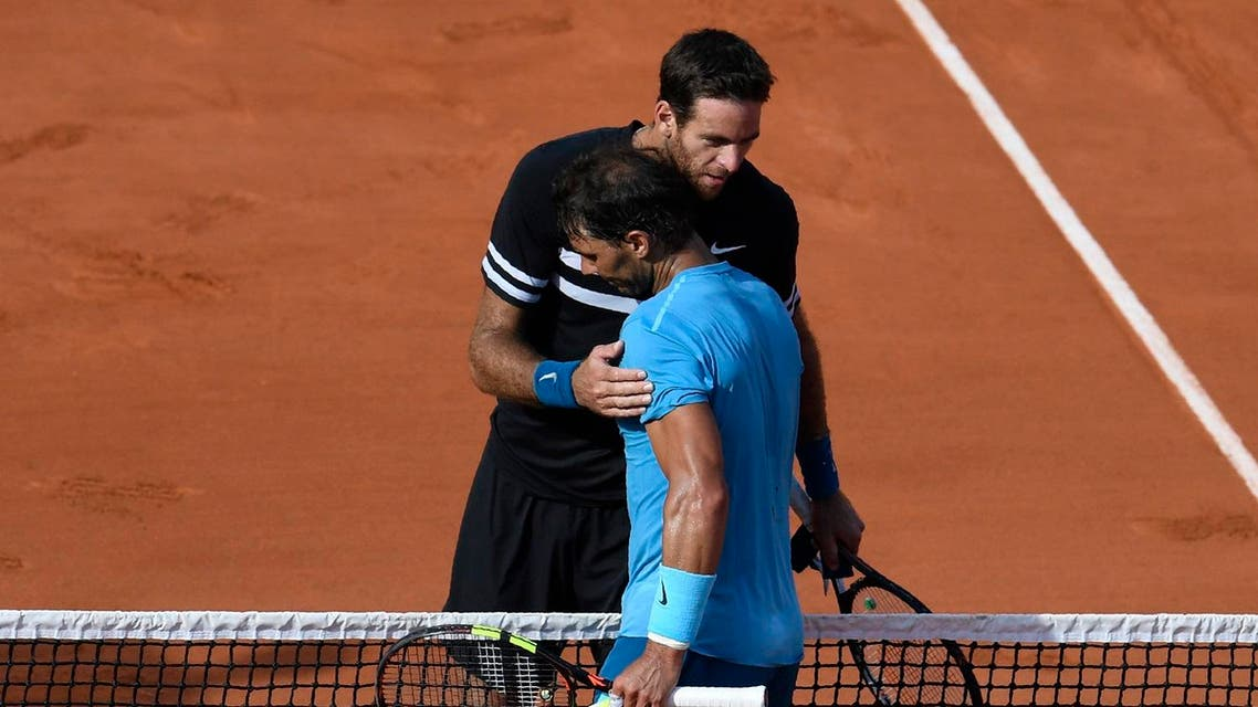 Rafael Nadal (L) embraces as he celebrates after victory over  Juan Martin del Potro in their men's singles semi-final at French Open in Paris on June 8, 2018. (AFP)