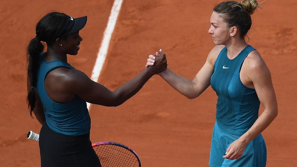 Simona Halep (R) shakes hands as she celebrates after victory over Sloane Stephens during their women's singles final atthe French Open in Paris on June 9, 2018. (AFP)