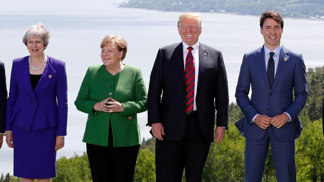Britain's Prime Minister Theresa May, Germany's Chancellor Angela Merkel, US President Donald Trump and Canada's Prime Minister Justin Trudeau pose during a family photo at the G7 Summit in the Charlevoix city of La Malbaie, Quebec, Canada, on June 8, 2018. (Reuters)
