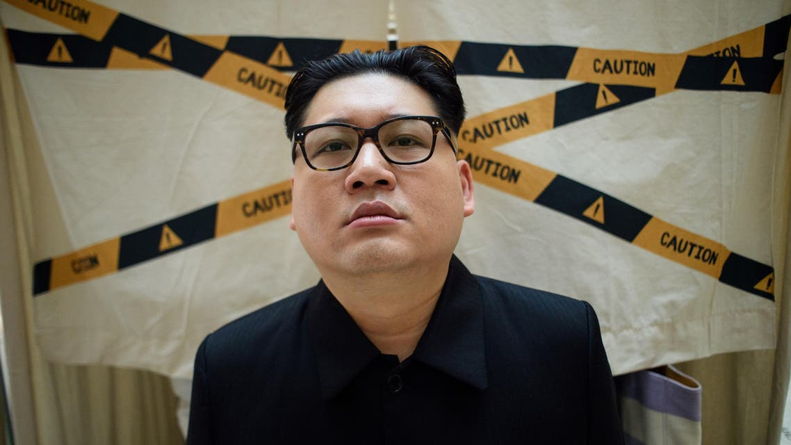 A Kim Jong Un impersonator, who goes by the name Howard X, poses while dressed up as the North Korean leader. (AFP)