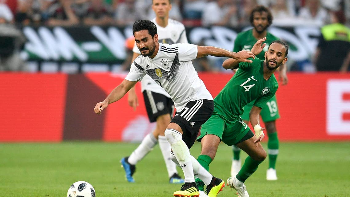 Germany's Ilkay Gundogan, left, duels for the ball with Saudi Arabia's Abdullah Otayf during a friendly soccer match between Germany and Saudi Arabia at BayArena in Leverkusen, Germany, Friday. (AP)
