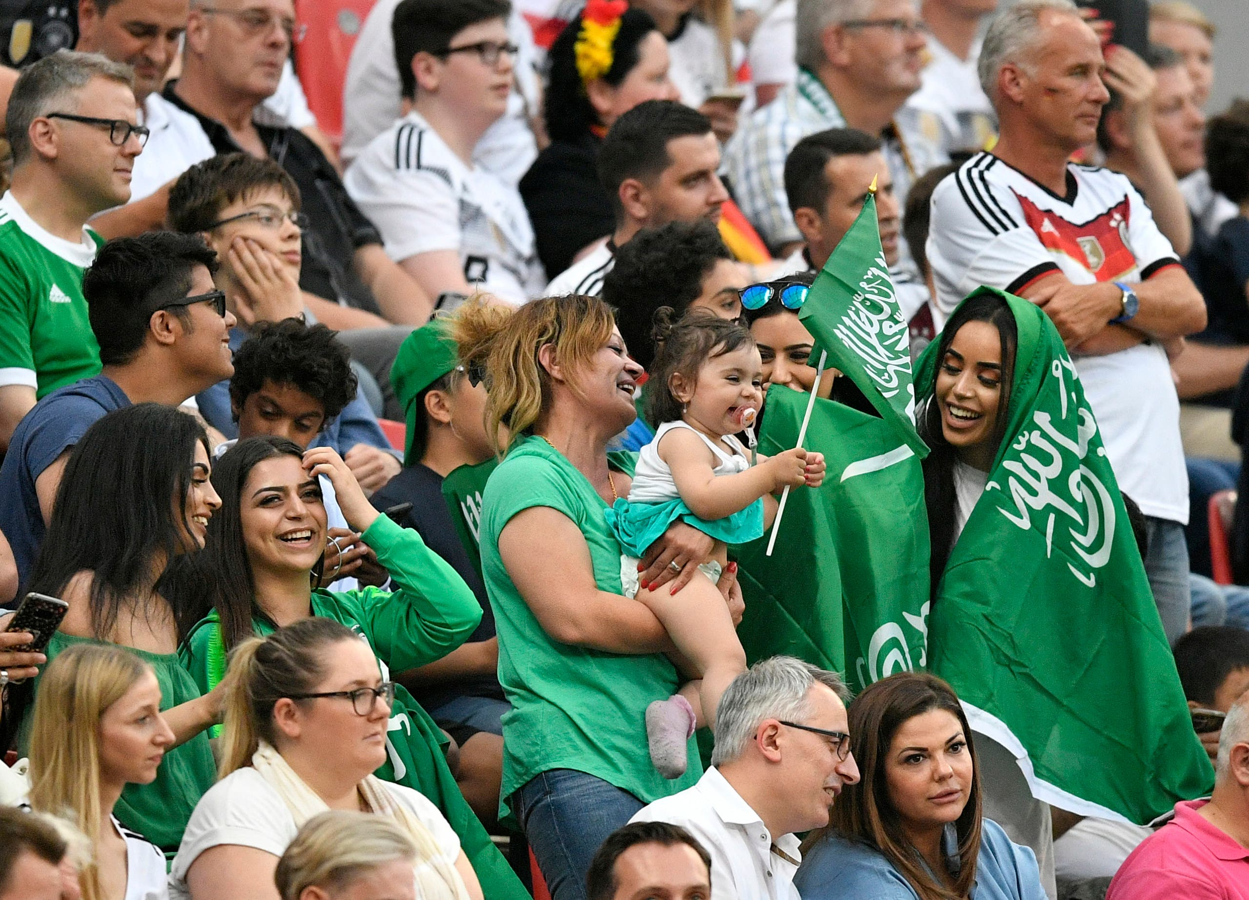 Saudi Arabia fans support their team during a friendly soccer match between Germany and Saudi Arabia at BayArena in Leverkusen, Germany, Friday. (AP)