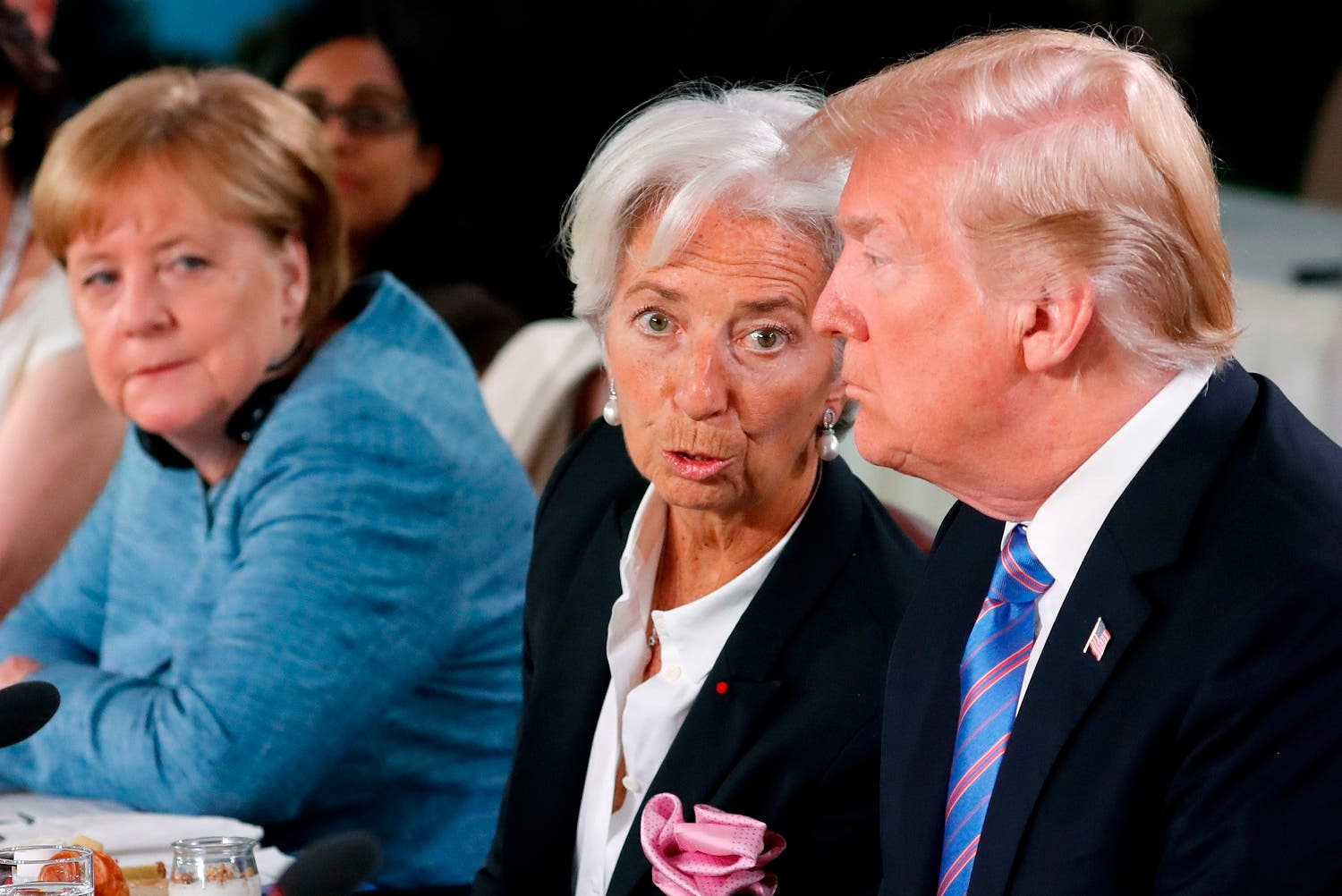President Donald Trump and International Monetary Fund (IMF) Director Christine Lagarde at the  G7 summit at La Malbaie in Quebec, Canada, on Saturday. (Reuters)