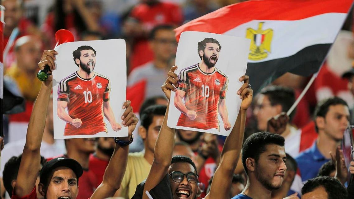 Fans hold poster of Egyptian national soccer team player and Liverpool's star striker Mohammed Salah during Egypt's final practice for the World Cup. (AP)