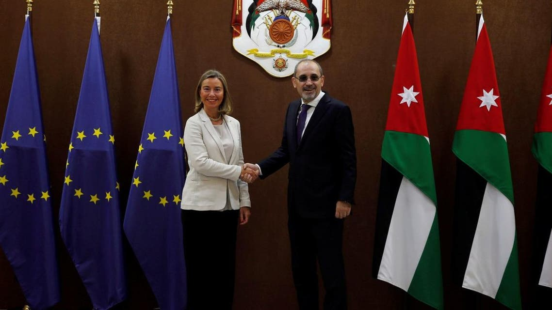 Jordanian Foreign Minister Ayman Safadi shakes hands with EU High Representative for Foreign Affairs Federica Mogherini in Amman. (Reuters)