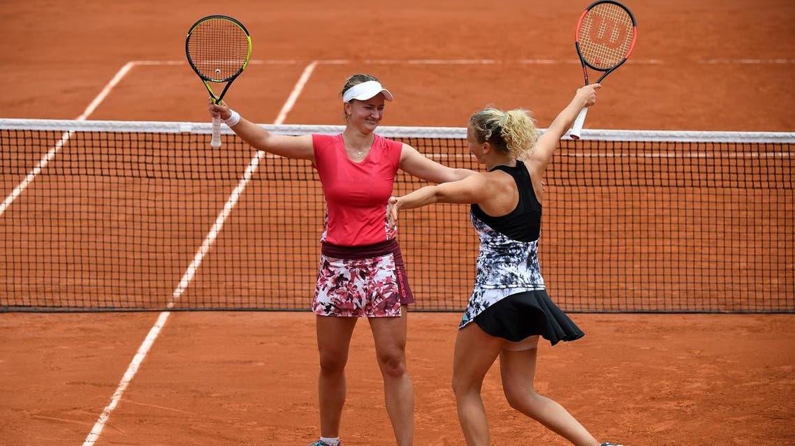 Czech Republic's Katerina Siniakova (R) and Barbora Krejcikova celebrate after victory over Japan's Eri Hozumi and Makoto Ninomiya during their women's doubles final. (AFP)