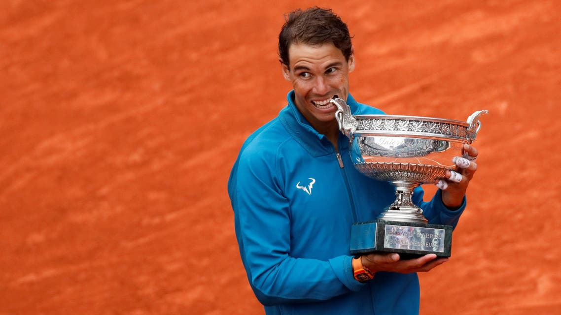 Nadal celebrates by biting the trophy after winning the final against Austria's Dominic Thiem on June 10, 2018. (Reuters)
