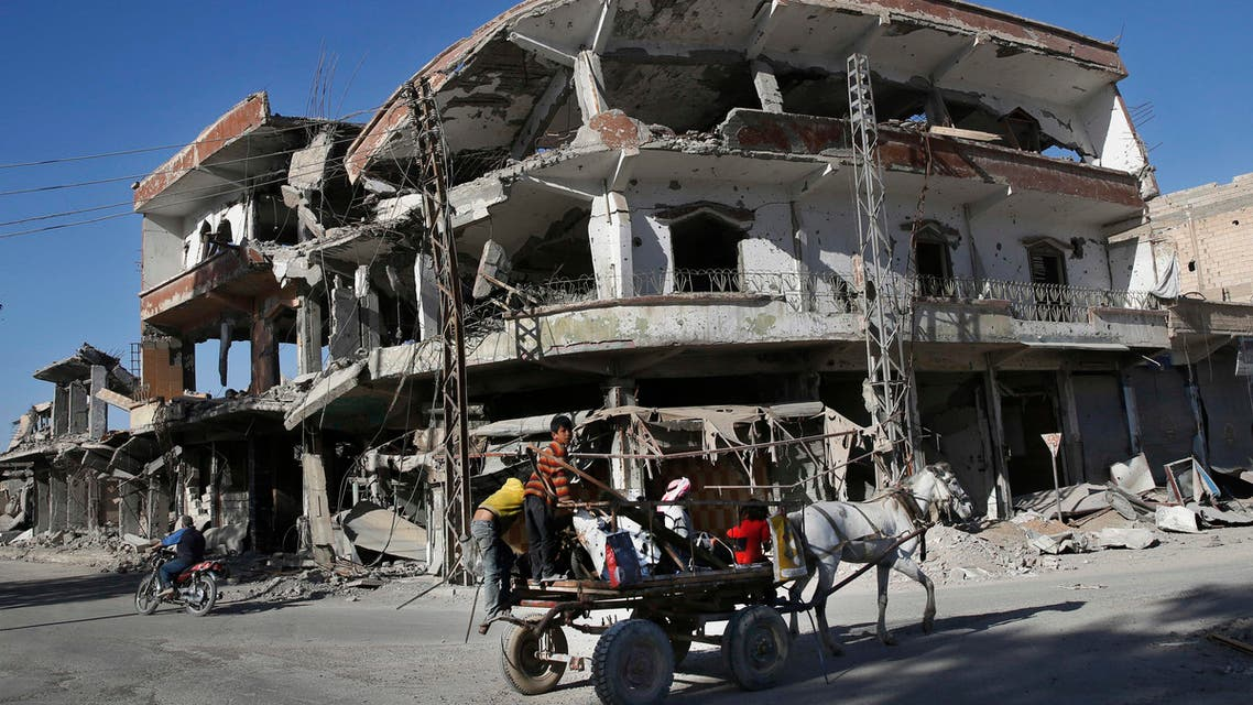 The remains of buildings line a street damaged during fighting between US-backed SDF and ISIS militants, in Raqqa, on April 5, 2018. (AP)