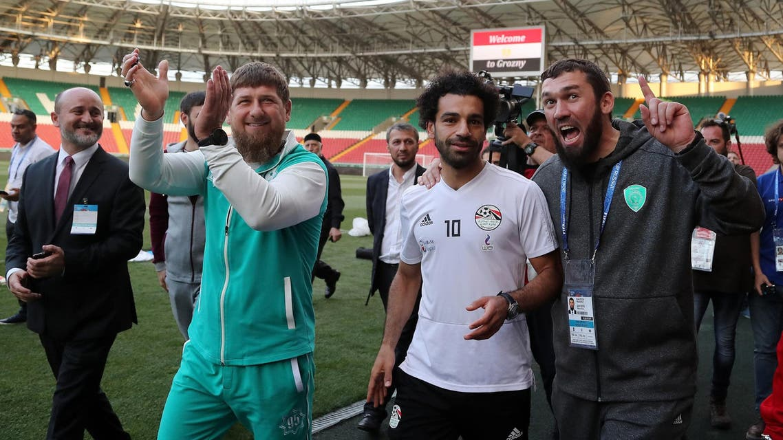 Mohamed Salah (R) and Ramzan Kadyrov during a training of Egyptian team at the Akhmat Arena stadium in Grozny on June 10, 2018. (AFP)
